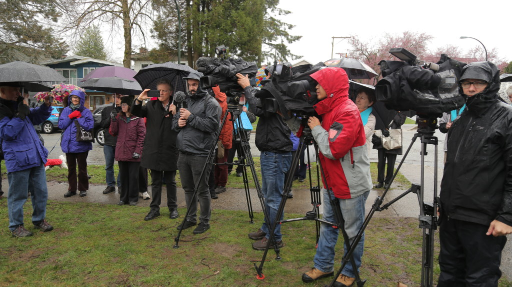 Media attend the ceremony for The Rich Coleman Vacant Lot